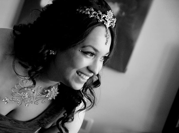 portrait of a bride laughing on her wedding day
