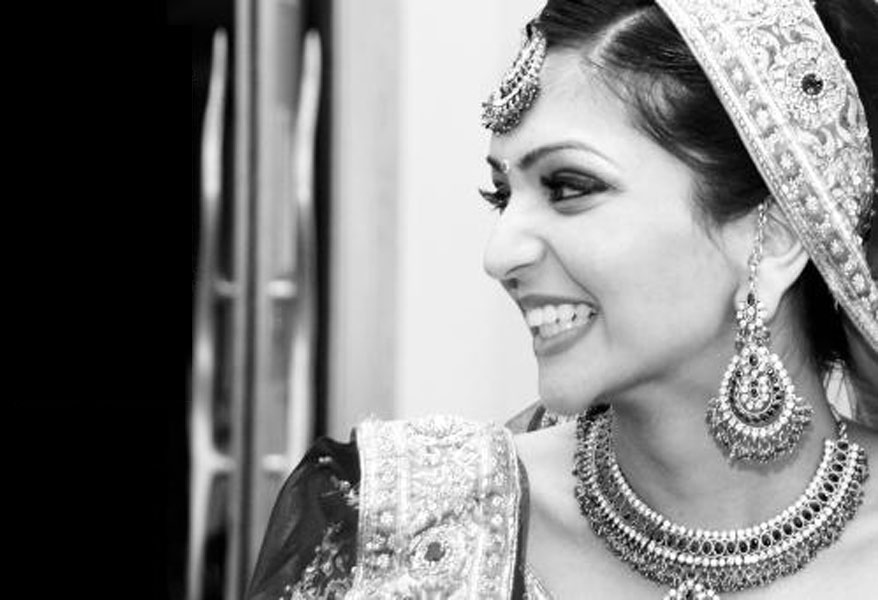 Indian bride laughing on her wedding day